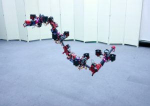 Flying Dragon Robot Transforms Itself to Squeeze Through Gaps