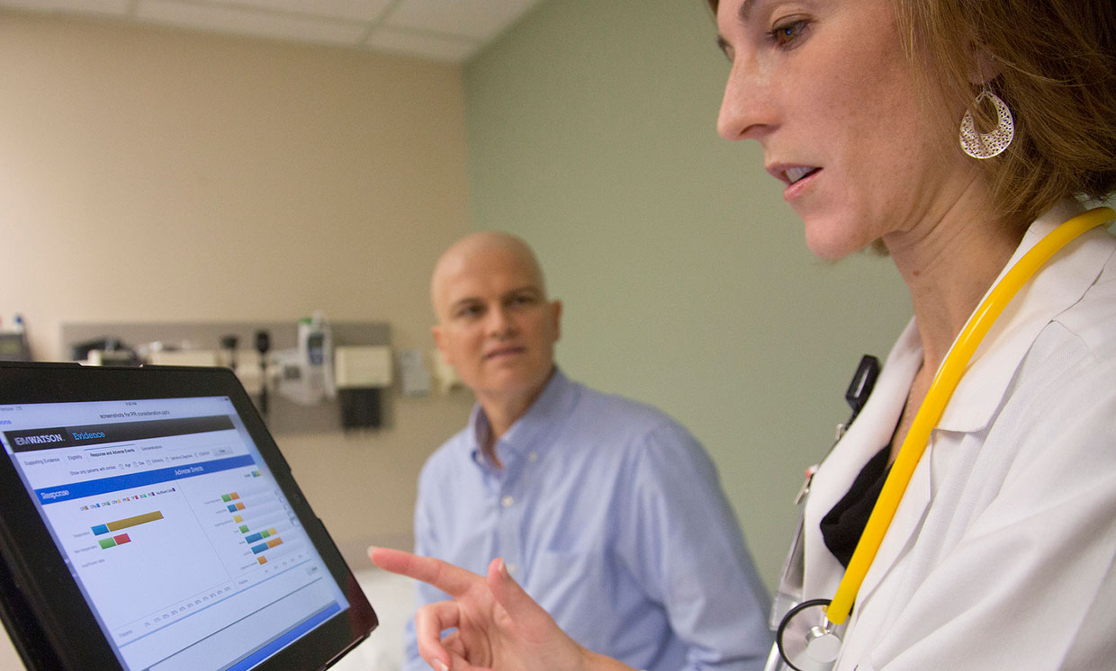 A University of Texas MD uses IBM's Watson cognitive system while consulting with patient.