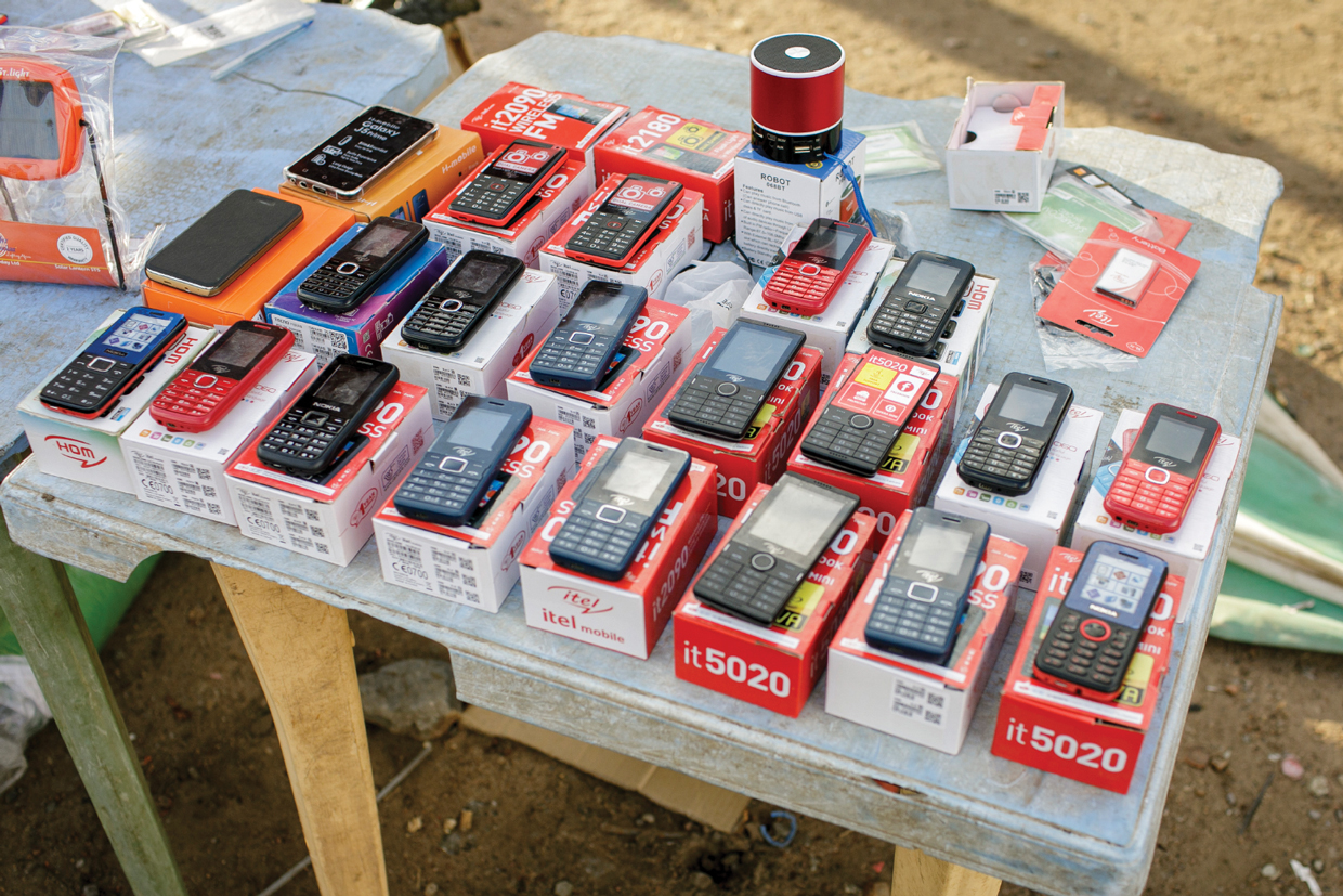 Photo of mobile phones displayed at a Kenyan market.