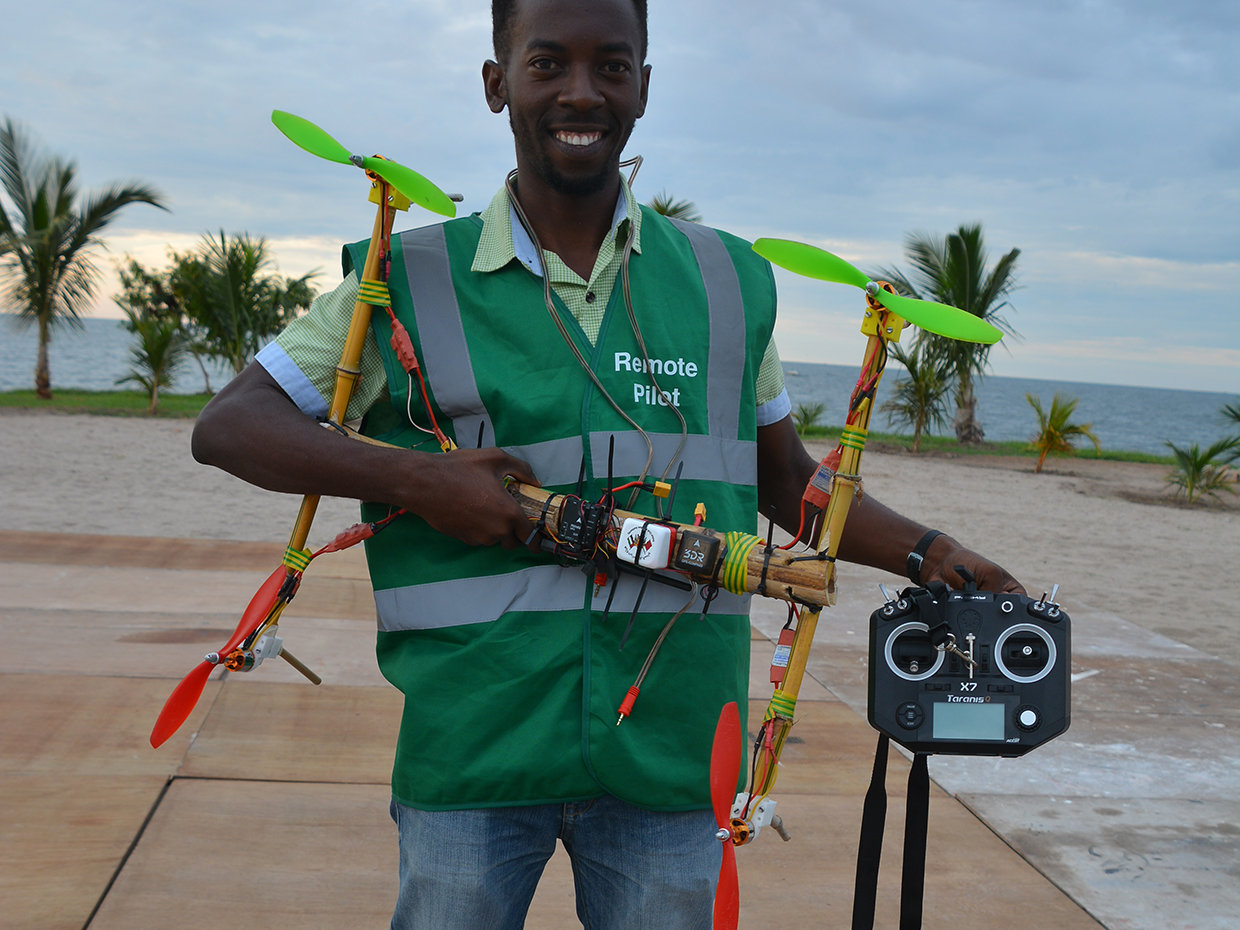 Photo of Bornlove Ntikha holding his drone.