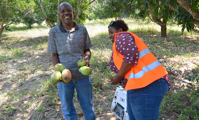 Imaging worker Rose Funja [right], and farmers Hashim Jabil,