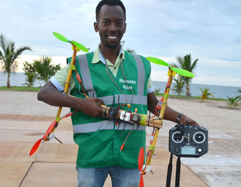 Bornlove Ntikha holding his DIY drone.